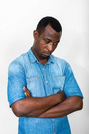 african business man: Portrait of handsome black African American man looking sad