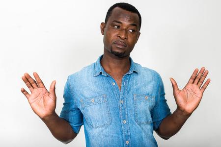 american sexy: Portrait of handsome black African American man having hands raised