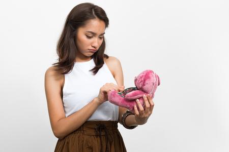 woman on phone: Woman using teddy bear as mobile phone