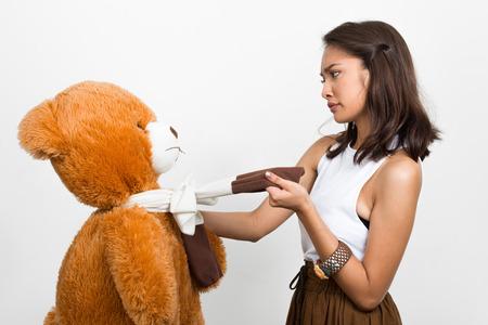 angry teddy: Beautiful Asian woman holding teddy bear Stock Photo