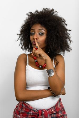 ethiopian ethnicity: African woman holding finger on lips Stock Photo