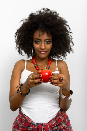 ethiopian ethnicity: African woman with apple