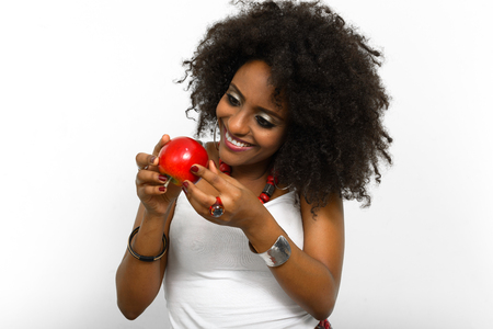 ethiopian ethnicity: African woman smiling with apple