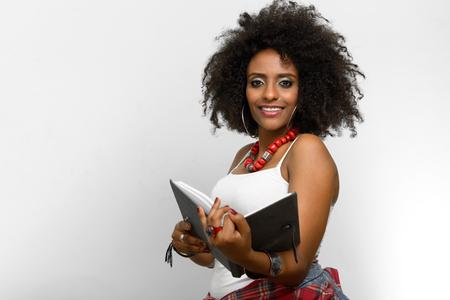 african american woman: African American woman holding book Stock Photo