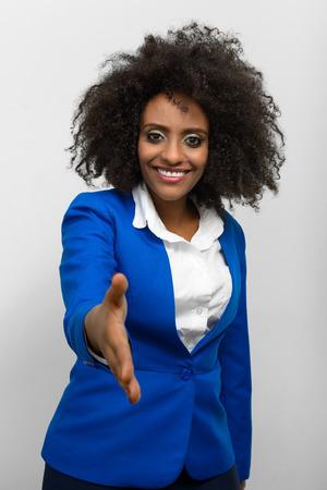 ethiopian ethnicity: Portrait of businesswoman offering handshake Stock Photo