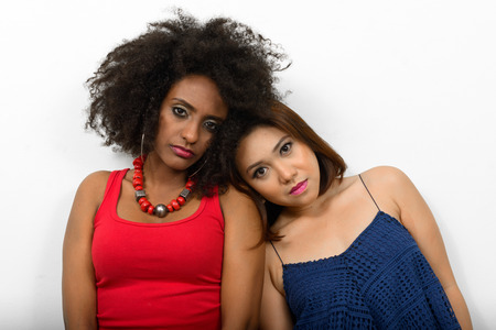 asian afro: Two woman couple on white surface  Stock Photo