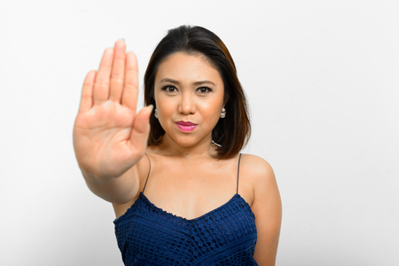 filipino adult: Woman pointing showing STOP! gesture