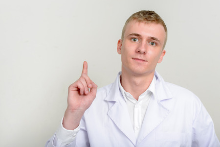 healthcare worker: Man healthcare worker pointing finger up Stock Photo