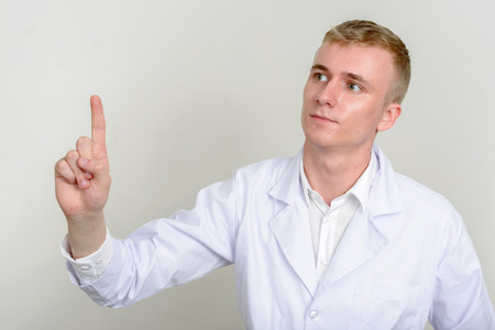 healthcare worker: Man healthcare worker pointing with finger