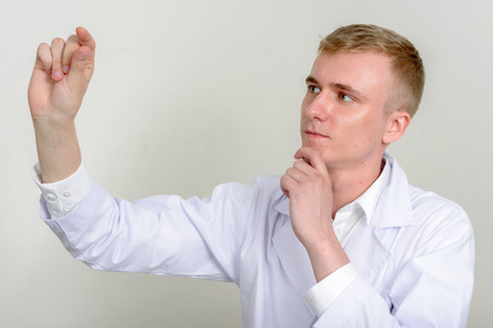 healthcare worker: Man healthcare worker thinking and measuring with his fingers
