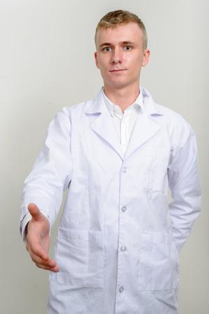healthcare worker: Healthcare worker offering handshake