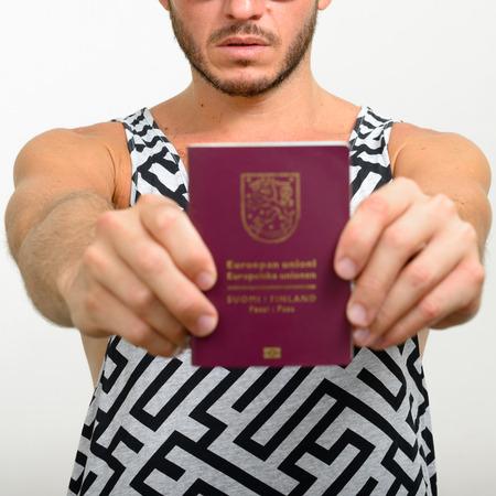 finnish: Man holding Finnish passport