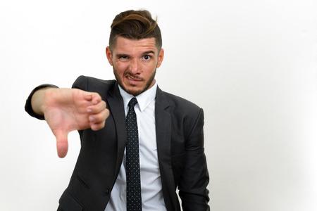 pessimist: Portrait of businessman showing thumb down Stock Photo