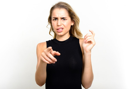 is disgusted: Portrait of blonde woman looking disgusted Stock Photo