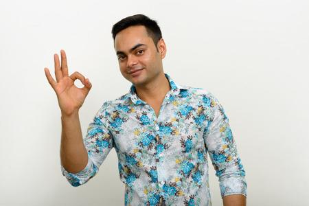 endorsing: Indian man making OK sign