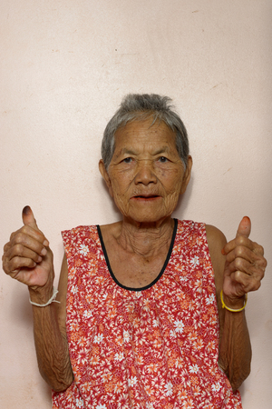 very: Very old Asian woman showing thumbs up Stock Photo