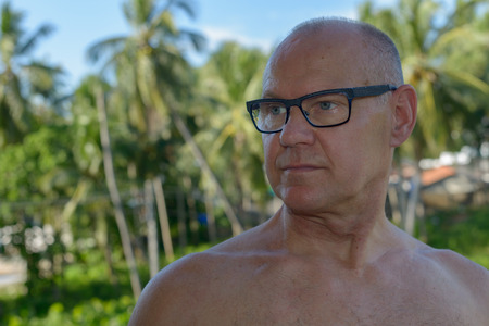 hairy chest: Portrait of handsome mature Caucasian man outdoors