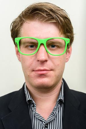 nerdy: Businessman wearing light green nerdy glasses Stock Photo