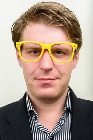 nerdy: Businessman wearing yellow nerdy glasses