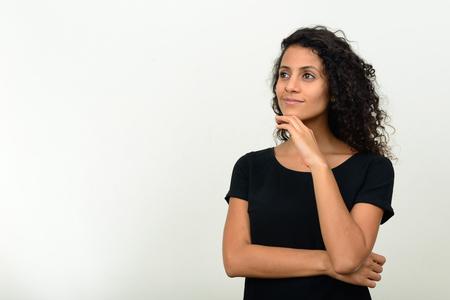 brazilian woman: Portrait of beautiful young Brazilian woman thinking Stock Photo