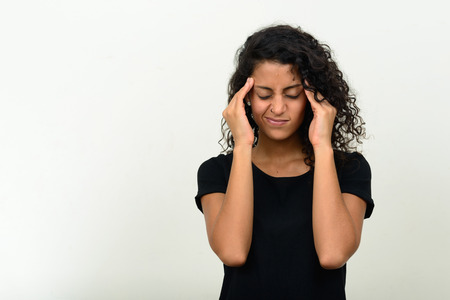 brazilian woman: Brazilian woman having stress and headache Stock Photo
