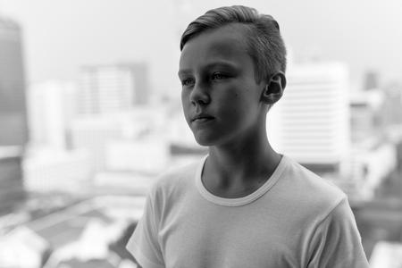 undercut: Black and white portrait of handsome Caucasian boy