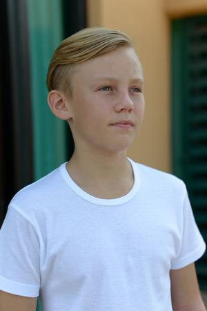 cute boys: Portrait of Caucasian boy standing outdoors