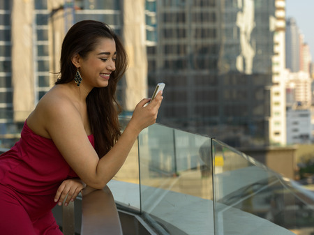 indian women: Indian woman outdoors using mobile phone