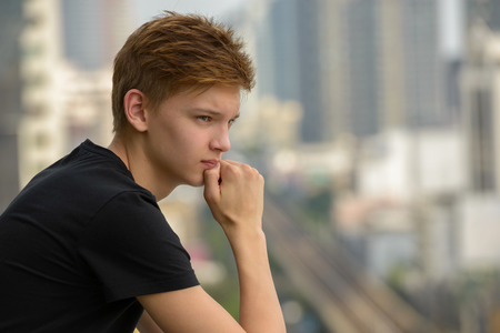 scandinavian people: Teenager boy outdoors in big city