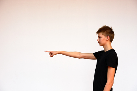 scandinavian people: Teenager boy standing against white background