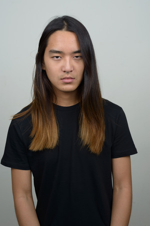 long: Asian man with long hairstyle Stock Photo