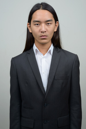 long: Asian businessman with long hairstyle Stock Photo
