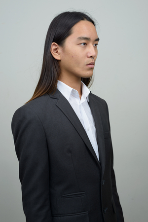 asian style: Asian businessman with long hairstyle Stock Photo