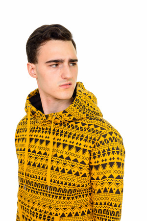 disgusted: Studio shot of young annoyed Caucasian man looking disgusted isolated against white background Stock Photo