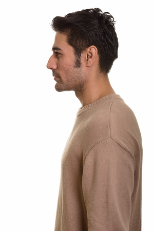 profile: Profile view of young handsome Persian man Stock Photo