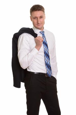 over the shoulder: Handsome Caucasian businessman with jacket over shoulder Stock Photo