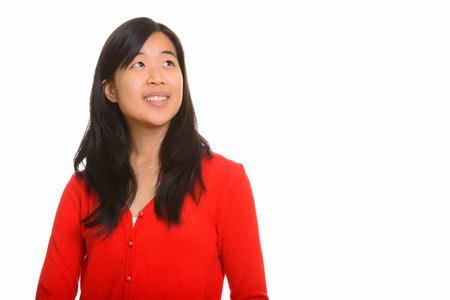 thinking woman: Young happy Asian woman thinking