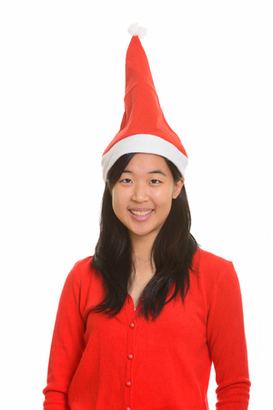 red cardigan: Young happy Asian woman ready for Christmas