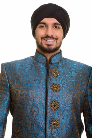 traditional clothes: Young happy Indian Sikh smiling wearing traditional clothes