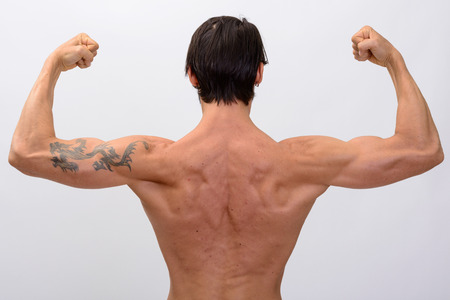 flexing: Back view of muscular man flexing both arms Stock Photo