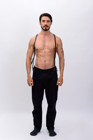 muscle guy: Full body shot of  handsome muscular man with suspenders standing shirtless