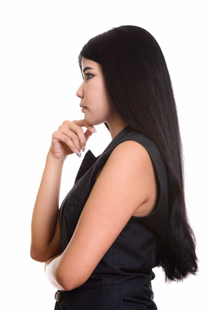 woman profile: Profile view of young Asian woman thinking