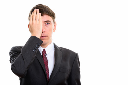 covering face: Studio shot of stressed businessman covering face Stock Photo