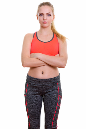 navel piercing: Studio shot of young beautiful teenage girl standing with arms crossed ready for gym Stock Photo