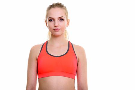 navel piercing: Studio shot of young beautiful teenage girl ready for gym Stock Photo