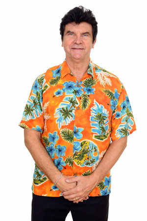 Studio shot of mature Caucasian man wearing Hawaiian shirt isolated against white background 免版税图像