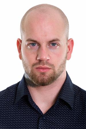 Studio shot of young bald muscular businessman