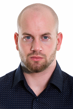 Studio shot of young bald muscular businessman
