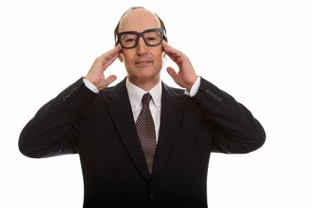 Studio shot of mature businessman having headache