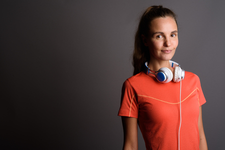 Young beautiful woman with long blond hair wearing headphones ag Stock Photo